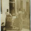 Black woman selling cabbages from a cart in Charleston, South Carolina