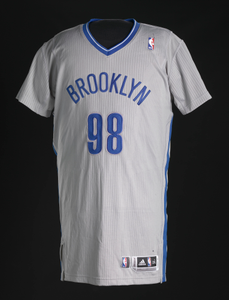 Basketball jersey for Brooklyn Nets worn by Jason Collins, signed by teammates