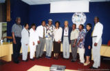 Administrators and educators with Glover and Belafonte