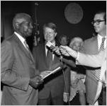 Governor Jimmy Carter with Dr. Benjamin E. Mays being interviewed by WSB, after receiving the Outstanding Older Georgian Award, Morehouse College, Atlanta, Georgia, August 6, 1971
