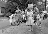 Photograph of Grace McKinley walking her daughter, Linda Gail McKinley to Fehr Elementary School, Nashville, Tennessee, 1957 September 09
