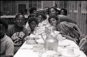 Inner City Round Table of Youth campers:group of African American campers at dining table, one wearing a Spirit in Flesh t-shirt