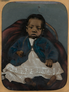 [Infant on Red Chair]