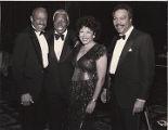 Photograph of Adellair Gay, Joe Williams, Anna Bailey, and Bob Bailey attending the Links Black and White Ball at Caesars Palace, November 28, 1987