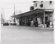 Mississippi State Sovereignty Commission photograph of the rear entrance to Stanley's Cafe and the Trailways bus depot with three African American males standing outside, Winona, Mississippi, 1961 November 1